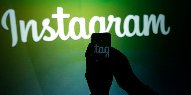 A journalist makes a video of the Instagram logo using the new video feature at Facebook headquarters in Menlo Park, Calif.,