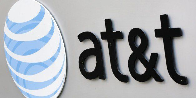 The corporate logo for AT&T is shown on the outside of one of its New York facilities, Tuesday, April 21, 2015. (AP Photo