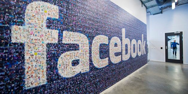 A big logo created from pictures of Facebook users worldwide is pictured in the company's Data Center, its first outside the