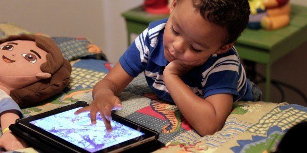 FILE - In this Friday, Oct. 21, 2011 file photo, Frankie Thevenot, 3, plays with an iPad in his bedroom at his home in Metair