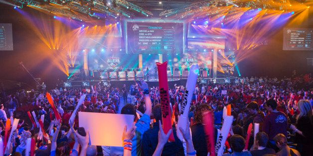 FILE - In this May 11, 2014 file photo, fans watch the opening ceremony of the League of Legends season 4 World Championship