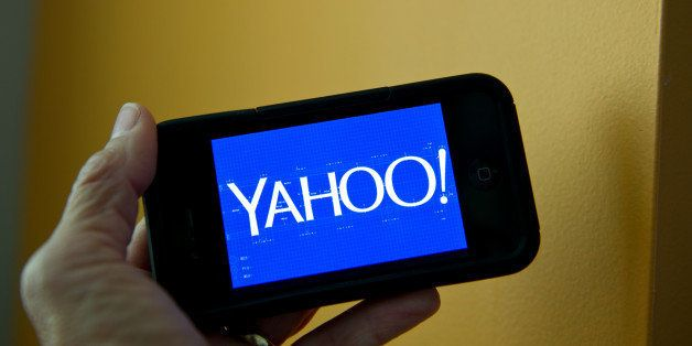 This September 12, 2013 photo illustration shows the newly designed Yahoo logo seen on a smartphone. Yahoo has refreshed its