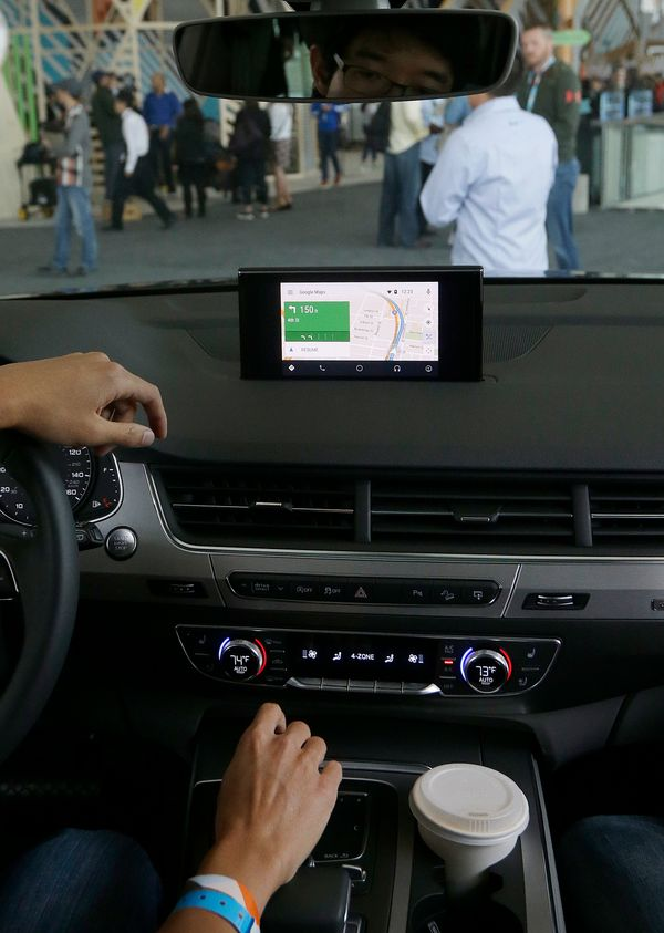 A Google employee gives a demonstration of Android Auto in an Audi during Google I/O 2015 in San Francisco. (AP Photo/Jeff Ch