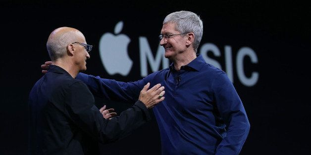SAN FRANCISCO, CA - JUNE 08:  Apple CEO Tim Cook (R) greets Johnny Iovine during the keynote address during Apple WWDC on Jun