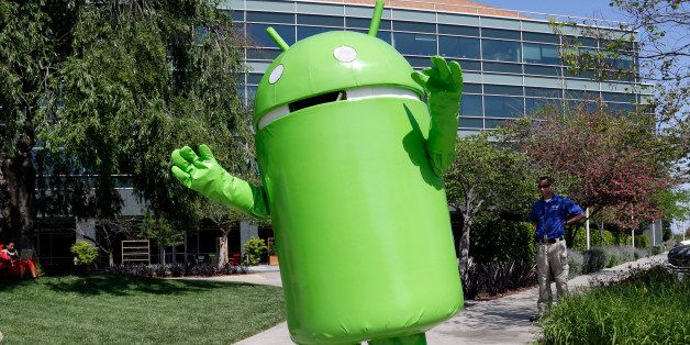 A person costumed as the Android operating system mascot greets visitors at Google headquarters in Mountain View, Calif., Thu