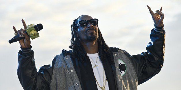 US rapper Snoop Dogg performs during the Grand Journal tv show, on the sidelines of the 68th Cannes Film Festival in Cannes, southeastern France, on May 19, 2015. AFP PHOTO / LOIC VENANCE (Photo credit should read LOIC VENANCE/AFP/Getty Images)