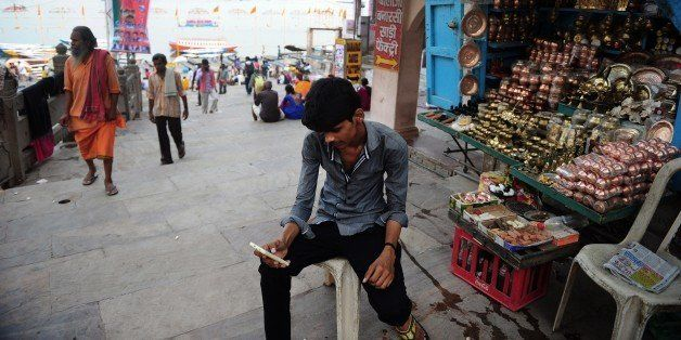 To go with ' India-Politics-Modi' FOCUS by Bhuvan BAGGA  In this photograph taken on May 10, 2015,  Indian stallholder Rite