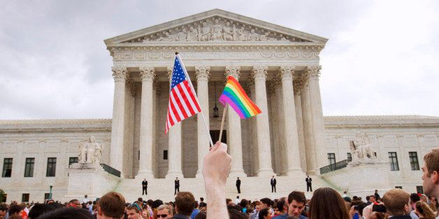 The crowd celebrates outside of the Supreme Court in Washington, Friday June 26, 2015, after the court declared that same-sex