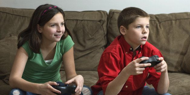 Siblings playing a video game