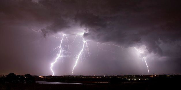 Lightning flashes over the eastern plains over Highlands Ranch, Colorado. The June storm front spun seven tornadoes over east