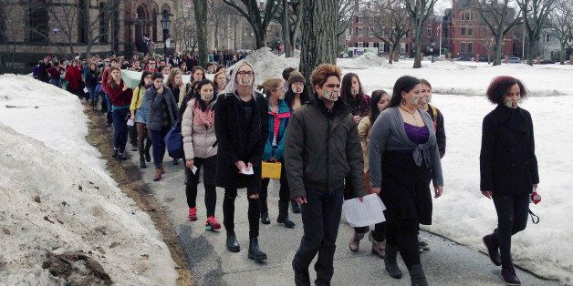 Hundreds of Brown University students march across campus, Wednesday, March 11, 2015, in Providence, R.I., to protest how the