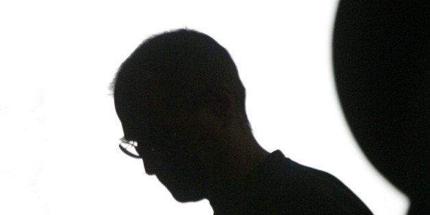 Apple Computer Inc. chief executive Steve Jobs is silhouetted in the Apple logo at the Moscone Center in San Francisco, Monda