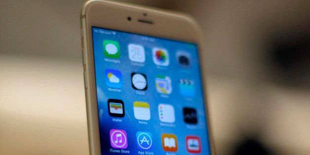 A new Apple iPhone 6S is displayed at an Apple store on Chicago's Magnificent Mile, Friday, Sept. 25, 2015, in Chicago. (AP P