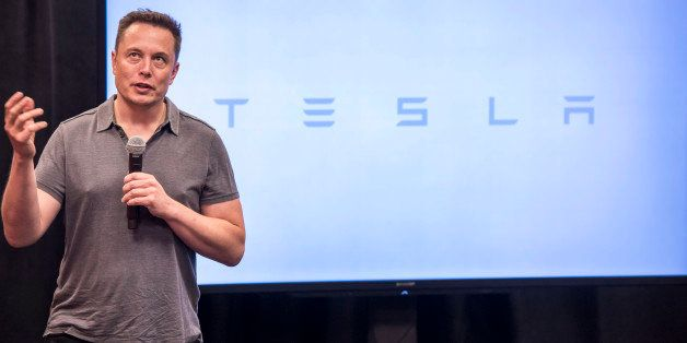 Elon Musk, chairman and chief executive officer of Tesla Motors, speaks during an event the company's headquarters in Palo Al