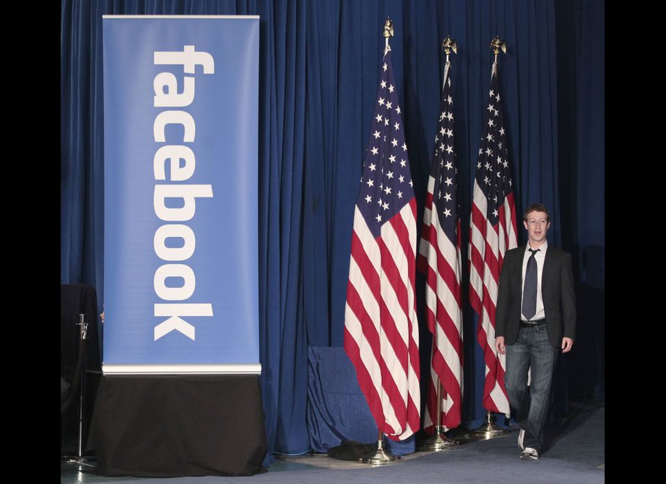 Facebook CEO Mark Zuckerberg is introduced for a town hall meeting, with President Barack Obama, to discuss reducing the nati