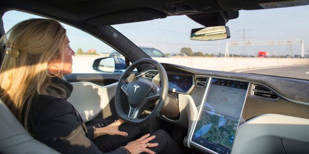 An employee drives a Tesla Motors Inc. Model S electric automobile, equipped with Autopilot hardware and software, hands-free