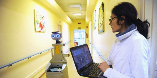 FLORENCE, ITALY - DECEMBER 18:  A caregiver controls a robot of the project Robot-Era position on the map of a GUI (Graphical