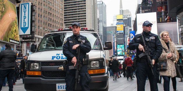 TIMES SQUARE, NEW YORK, NY, UNITED STATES - 2015/12/31: Heavily armed NYPD counterterrorism officers stand at post near the e
