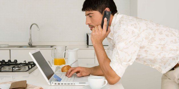 Man with laptop and cell phone