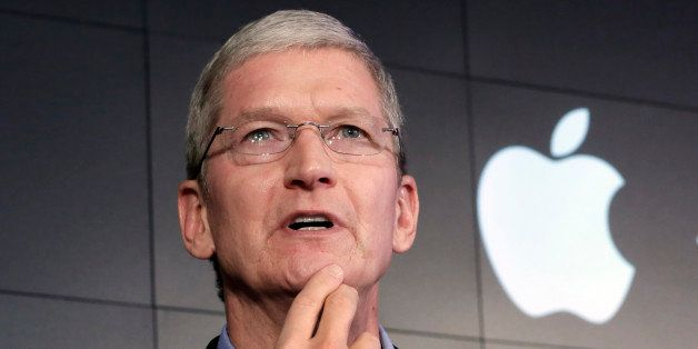 FILE - In this April 30, 2015, file photo, Apple CEO Tim Cook responds to a question during a news conference at IBM Watson h