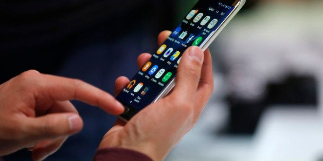 A man holds the Samsung Galaxy S7 Edge during the Samsung Galaxy Unpacked 2016 event on the eve of this week's Mobile World