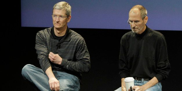 In this July 16, 2010 photo shows Apple's Tim Cook, left, and Steve Jobs, right, during a meeting at Apple in Cupertino, Cali