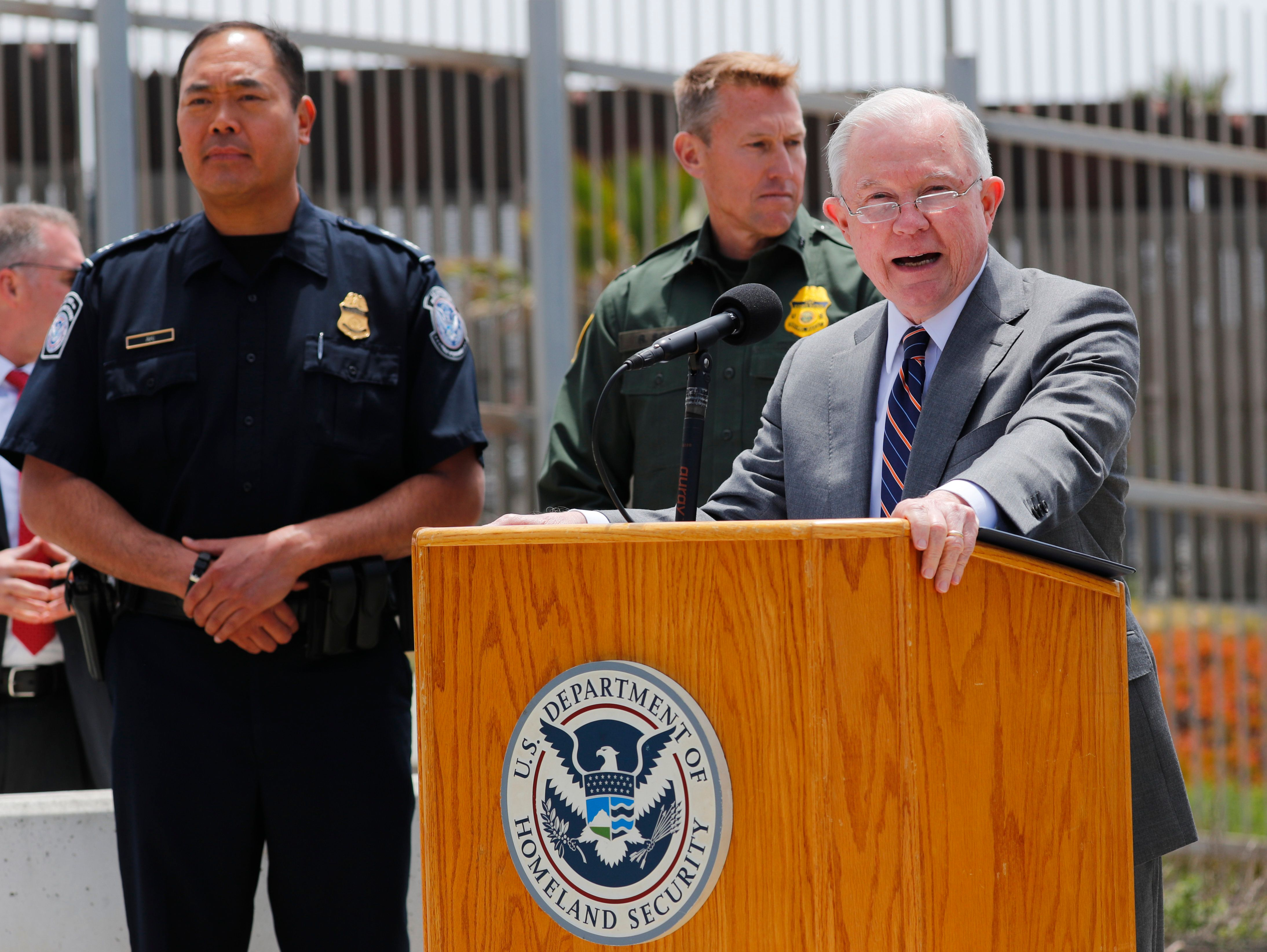 U.S. Attorney General Jeff Sessions speaks during a visit to the U.S. Mexico border wall for a press conference with Immigration and Customs Enforcement Deputy Director Thomas D. Homan, discussing immigration enforcement actions of the Trump Administration near San Diego, California, U.S. May 7, 2018. REUTERS/Mike Blake