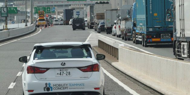 Toyota Motor Corp., automated driving test vehicle enters a highway on-ramp in Tokyo, Tuesday, Oct. 6, 2015.  Toyota unveiled