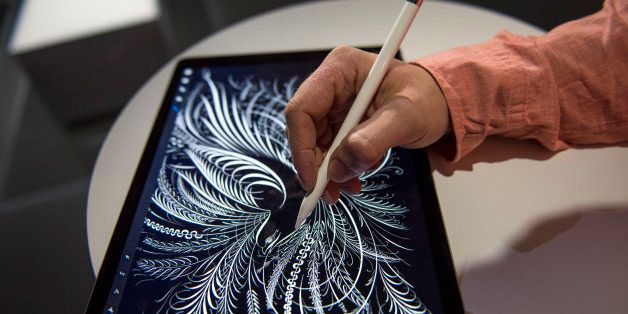 An exhibitor demonstrates the new Apple Pencil with the Apple Inc. iPad Pro tablet computer after a product announcement in S