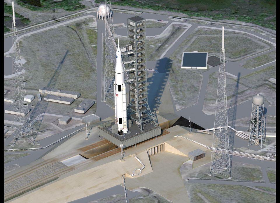 Artist concept of SLS on launchpad. (NASA)