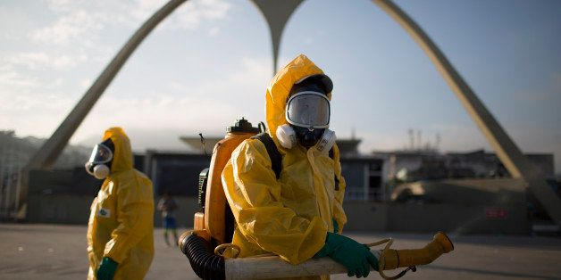 FILE - In this Tuesday, Jan. 26, 2016 file photo, a health workers stands in the Sambadrome spraying insecticide to combat th