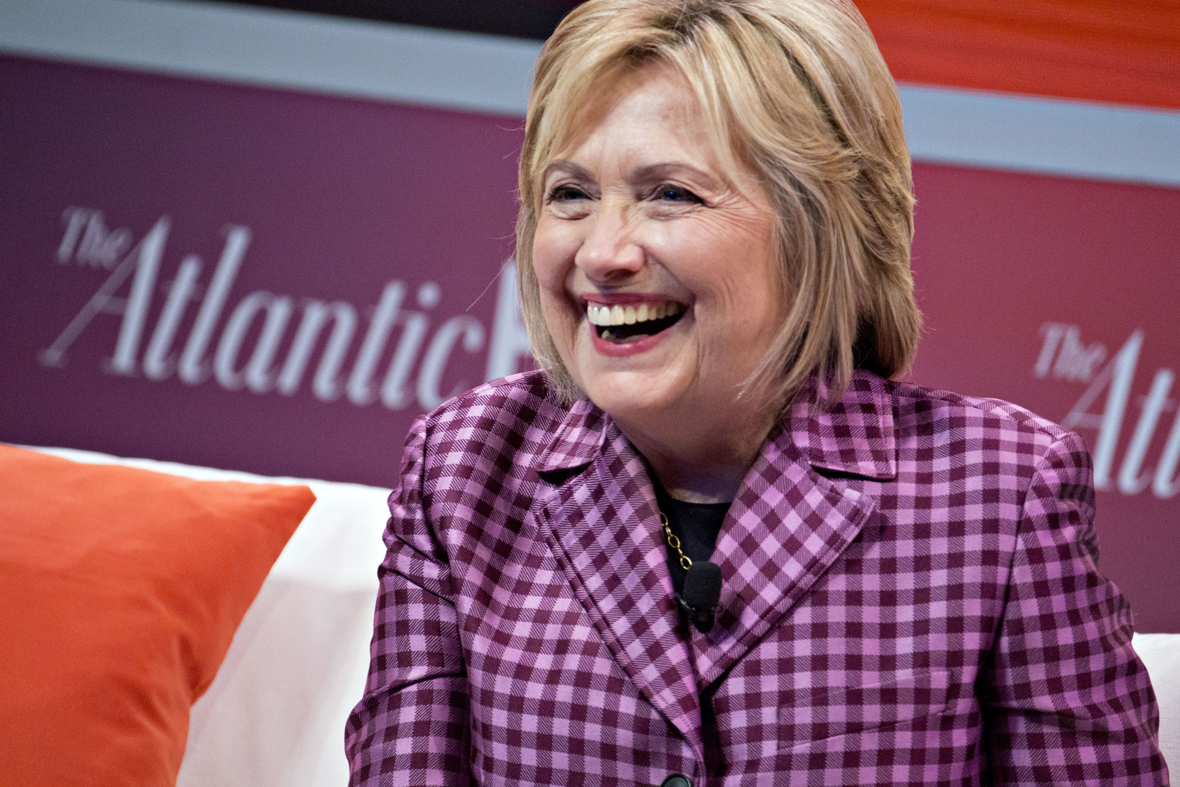 Hillary Clinton, former U.S. secretary of state, laughs during an Atlantic Festival discussion in Washington, D.C., U.S., on Tuesday, Oct. 2, 2018. Clinton said that Supreme Court nominee Brett Kavanaugh deserves a lot of laughter for his claim that revenge on behalf of the Clintons is one of the motives for opposition to his confirmation. Photographer: Andrew Harrer/Bloomberg via Getty Images