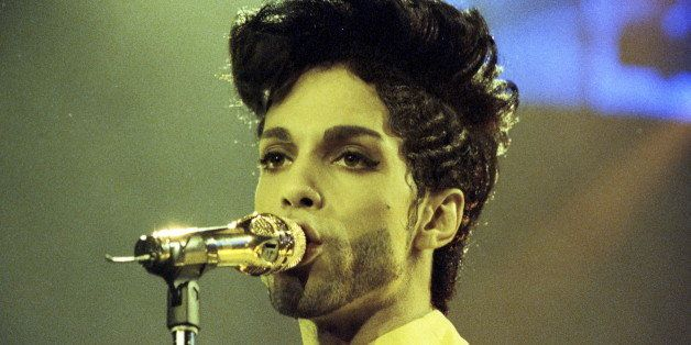 Prince performs during his 'Diamonds and Pearls Tour' at the Earl's Court Arena in London, Britain, June 15, 1992.   REUTERS/