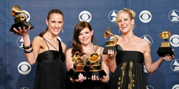 The Dixie Chicks (L-R) Emily Robison, Natalie Maines and Martie Maguire pose with their Grammys at the 49th Annual Grammy Awa