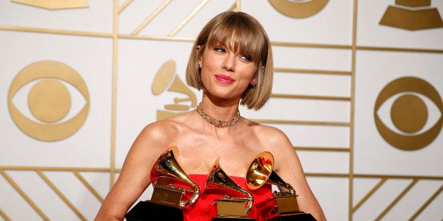 "Singer Taylor Swift poses backstage with her awards for Best Music Video for ""Bad Blood"", Album of the Year and Best Pop Voca"