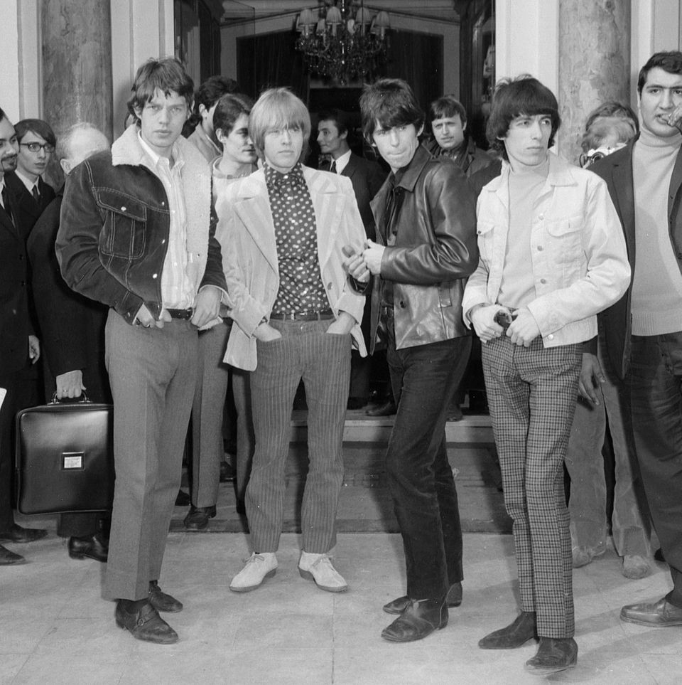 Members of the British rock band the Rolling Stones pose 28 March 1966 in Paris. Left to right: Mick Jagger, Brian Jones, Kei