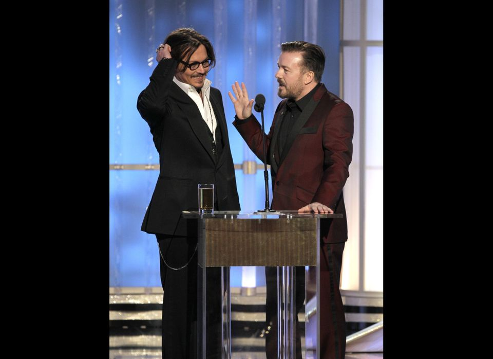 BEVERLY HILLS, CA - JANUARY 15: In this handout photo provided by NBC, actor Johnny Depp (L) and host Ricky Gervais talk onst