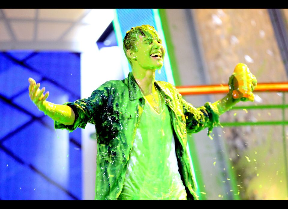 LOS ANGELES, CA - MARCH 31: Singer Justin Bieber gets slimed at Nickelodeon's 25th Annual Kids' Choice Awards held at Galen C