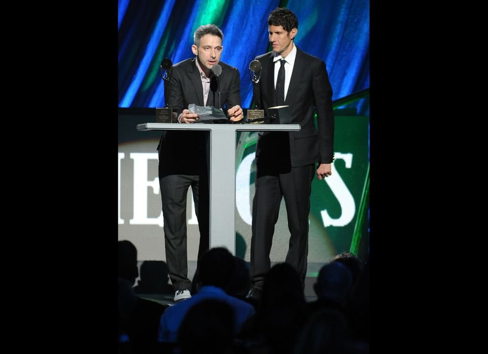 Inductees Adam Horovitz AKA ADROCK (L) and Michael Diamond AKA Mike D (R) of the Beastie Boys speak onstage during the 27th A