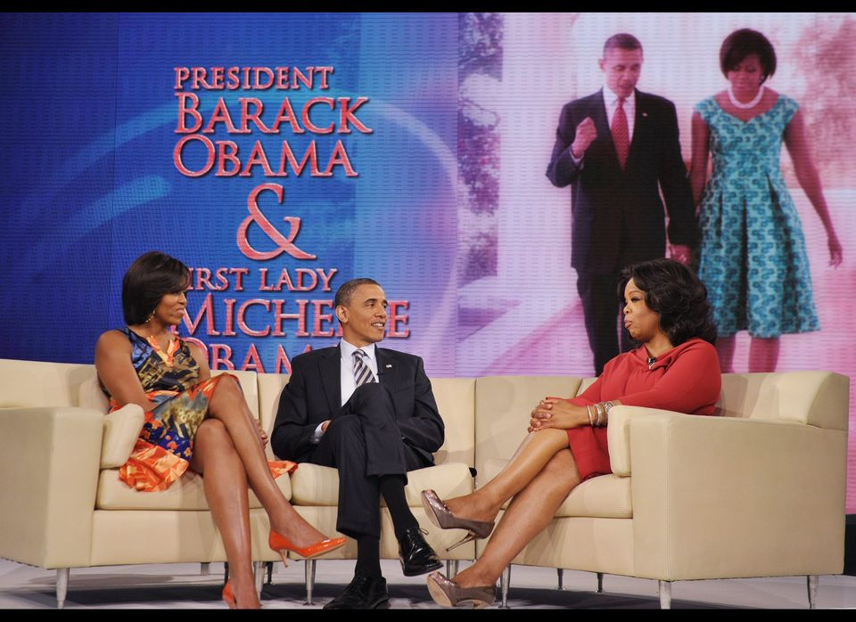 US President Barack Obama and First Lady Michelle Obama chat with talk show host Oprah Winfrey during a taping of the Oprah W
