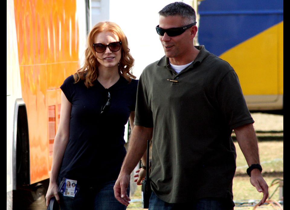 Jessica Chastain (L) walks on the set of director Kathryn Bigelow's forthcoming film on Osama bin Laden, in Chandigarh on Mar