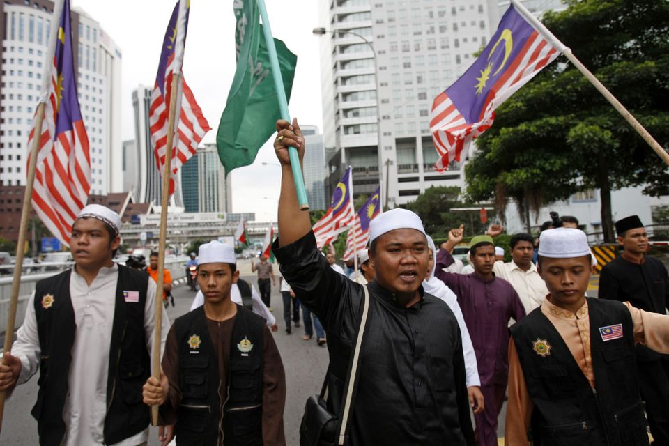 Malaysian Muslims shout a slogan as they march to the U.S. Embassy during a protest in Kuala Lumpur, Malaysia, Friday, Sept.