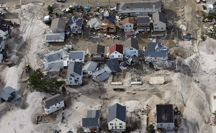 SEASIDE HEIGHTS, NJ - OCTOBER 31: Homes wrecked by Superstorm Sandy sit amongst sand washed ashore on October 31, 2012 in Sea