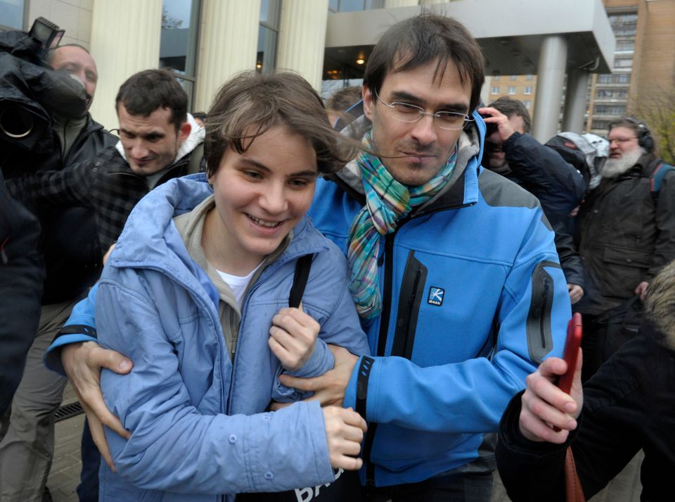 Freed feminist punk group Pussy Riot member Yekaterina Samutsevich, left, leaves a court in Moscow, Wednesday, Oct. 10, 2012.