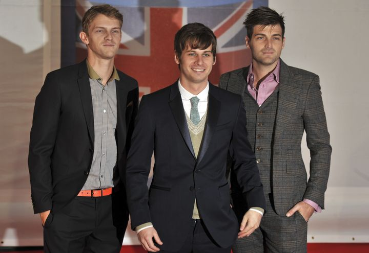 (L-R) Mark Pontius, Mark Foster and Cubbie Fink of band Foster The People pose on the red carpet arriving at the BRIT Awards