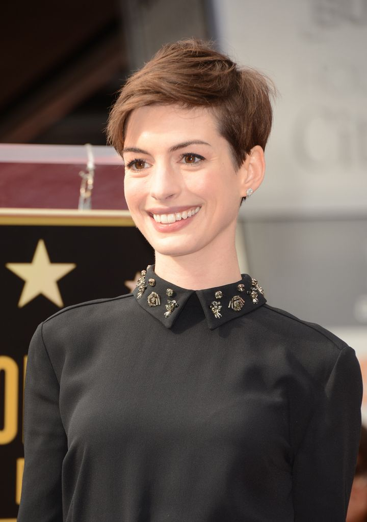 HOLLYWOOD, CA - DECEMBER 13:  Actress Anne Hathaway attends the Hugh Jackman Hollywood Walk Of Fame ceremony on December 13,