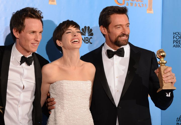 From left: Eddie Redmayne, Anne Hathaway and Hugh Jackman pose with the best motion picture comedy or musical award for 'Les