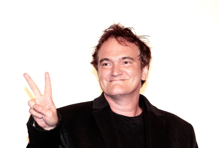 TOKYO, JAPAN - FEBRUARY 13:  Director Quentin Tarantino poses for photos before the special screening of 'Django Unchained' a