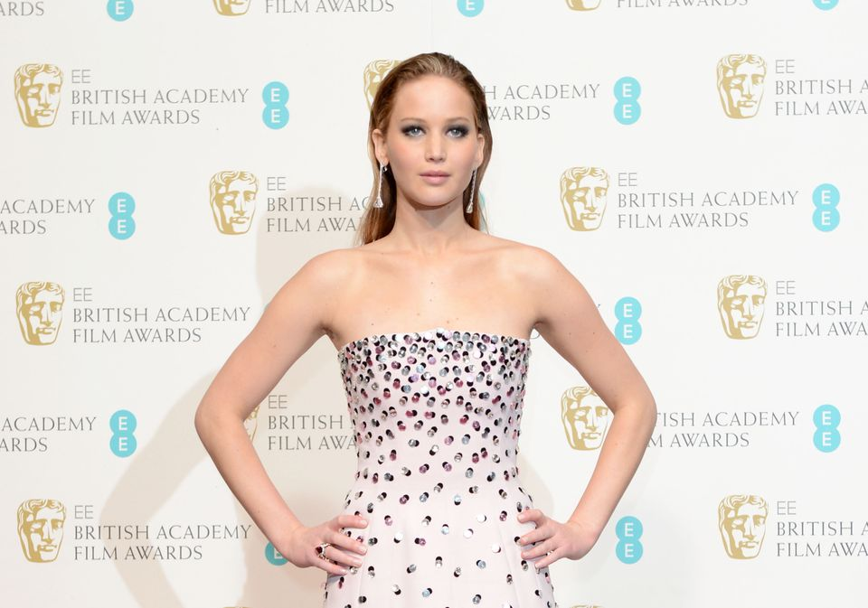 Jennifer Lawrence poses backstage at the BAFTA Film Awards at the Royal Opera House on Sunday, Feb. 10, 2013, in London. (Pho