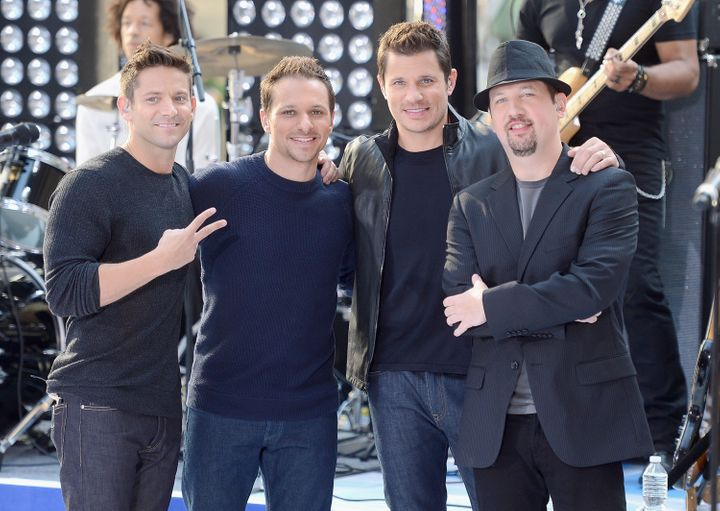 NEW YORK, NY - AUGUST 17:  (L-R)  Justin Jeffre, Drew Lachey, Nick Lachey and Jeff Timmons of 98 Degrees  performs on NBC's '